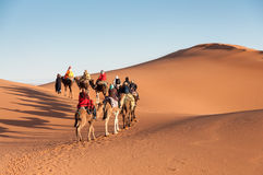 Caravan with tourists in the sahara desert Stock Photos