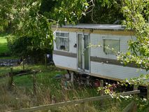 Caravan, trailer, living rough, by the river Stock Photo