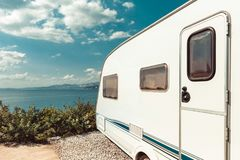Caravan Trailer Near Sea, Beach And Blue Sky. Summer Holidays Road Trip Travel Concept. Caravan Trailer Near Sea, Beach And Blue Sky. Summer Holidays Road Trip royalty free stock photography