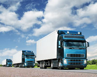 Caravan of  trucks, cargo transportation concept. Convoy of trucks on highway, cargo transportation concept Stock Image