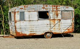Caravan. White and brown and trees Royalty Free Stock Photos