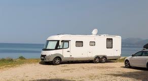 Caravan by the sea summer holidays. Caravan  white by the sea summer holidays Royalty Free Stock Image