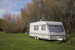 Caravana en el camping Imágenes de archivo libres de regalías