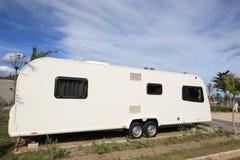 Caravana grande en un camping Imagen de archivo libre de regalías