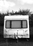 Caravana vieja sucia de la reducción de BW fotografía de archivo libre de regalías