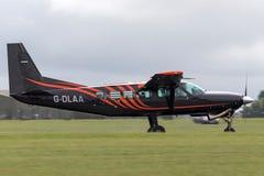 Caravane G-DLAA de Cessna 208 sur la piste après le débarquement images libres de droits