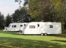 Caravans on camp site. Two recreational caravans on a camping site in Surrey, England Stock Images