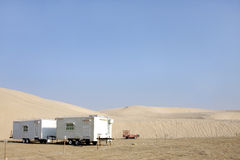 Caravans near sand dunes Stock Photo