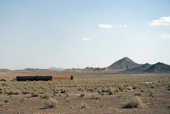 Caravanserairuinen in der Iran-der Wüste Stockfotos