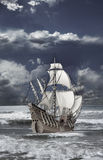 Caravel floating on the waves of sea Royalty Free Stock Photography