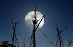 Caravel. Masts silhouette of an old Portuguese caravel replica at full moon light Stock Images