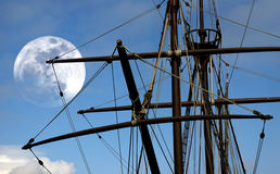 Caravel. Old Portuguese caravel against a full moon sky Stock Image