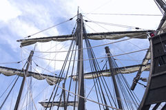 Caravel Ship Masts Sails and Ropes. Masts of caravel style vessel with sails tied up on cross beams and ropes crossing deck Stock Photo