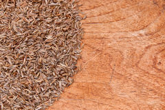 Caraway on wood Stock Images