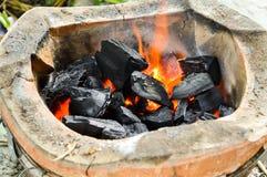 Carbón caliente en estufa foto de archivo libre de regalías