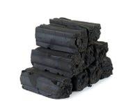 Carbón de leña aislado en el fondo blanco Imagen de archivo libre de regalías