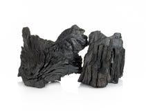 Carbón de leña de madera aislado en el fondo blanco Imagen de archivo