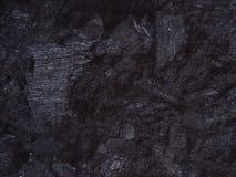 Carbón, negro de la textura del fondo de las pepitas del carbón foto de archivo