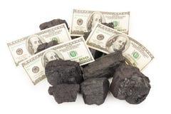 Carbón y dinero fotografía de archivo