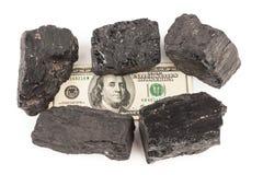 Carbón y dinero Foto de archivo libre de regalías