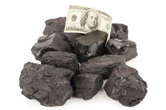 Carbón y dinero Foto de archivo