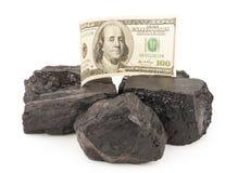 Carbón y dinero Fotos de archivo libres de regalías
