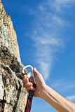 Carbine and hook with rope in stone Royalty Free Stock Photos