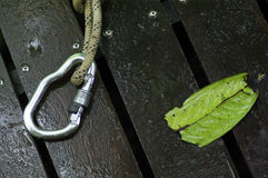 Carbine and hook with rope on wood floor Stock Images