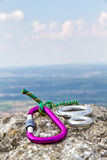 Carbine and rope on a rock Stock Photo