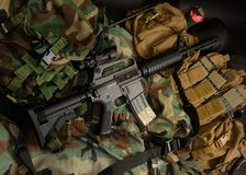 Carbine with tactical chest rigs. Military Equipment stock photography