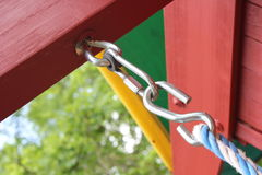 Carbiner and hook. For a swing in a outdoor swing set Royalty Free Stock Photo