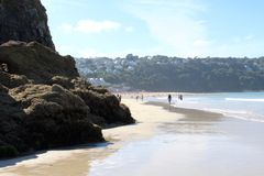 Carbis Bay. Landscape view of sandy beach and blue sky and craggy rocks in Cornwall, United Kingdom near St Ives royalty free stock photo