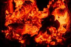 Carbón ardiente Foto de archivo libre de regalías