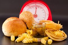 Carbohydrate. Foods high in carbohydrate on a scales stock photos
