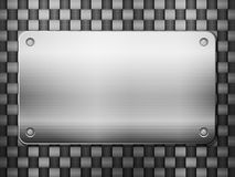 Carbon background and metal plate Royalty Free Stock Photos