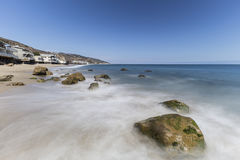 Carbon Beach Malibu California. Oceanfront homes with motion blur waves at Carbon Beach in Malibu, California Royalty Free Stock Images