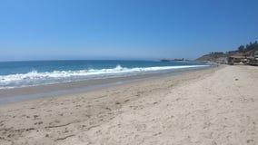 Carbon Beach of Malibu. Carbon Beach or Billionaire Beach of Malibu. Malibu Pier on background. California West Coast landscape. Blue sky, copy space. Summer stock video footage