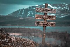 Free Carbon Capture Technology Text Quote Engraved On Wooden Signpost Outdoors In Landscape Looking Polluted Stock Photography - 212996572
