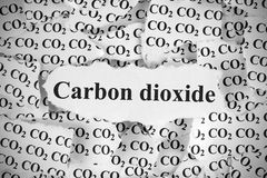 Carbon Dioxide. Torn pieces of paper with the word Carbon Dioxide. Black and White. Close-up Stock Image