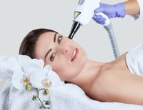 Carbon face peeling procedure in a beauty salon. Hardware cosmetology treatment royalty free stock image