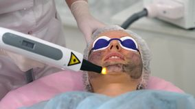 Carbon face peeling procedure. Royalty Free Stock Images