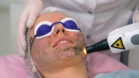 Carbon face peeling procedure. Royalty Free Stock Photo