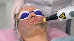 Carbon face peeling procedure. Royalty Free Stock Image