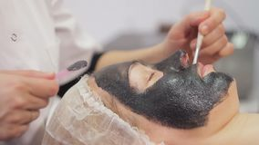Carbon face peeling procedure. Laser pulses clean skin of the face. Hardware cosmetology treatment. Facial skin. Carbon face peeling procedure. Laser pulses stock video footage