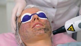 Carbon face peeling procedure. Stock Images