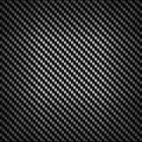 Carbon or fiber background texture. With a repeat diagonal pattern and central highlight in a striking geometric design Royalty Free Stock Photography