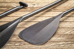 Carbon fiber canoe or SUP paddles royalty free stock photos