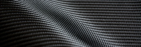 Carbon fiber composite raw material. Background Stock Image