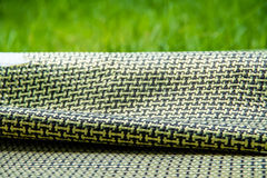 Carbon fiber composite raw material background Royalty Free Stock Image