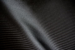 Carbon fiber composite raw material background Royalty Free Stock Photo